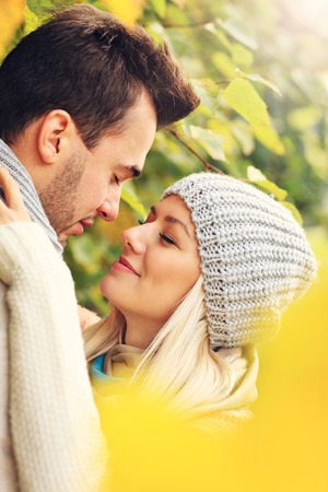 love kissing: A picture of a young romantic couple in the park in autumn