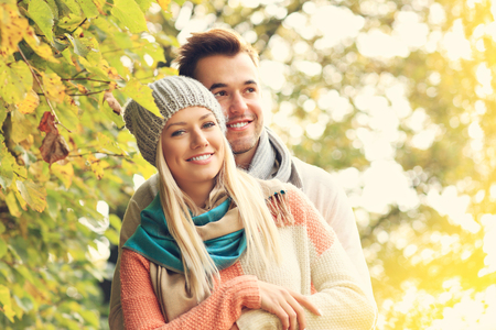 romantic hug: A picture of a young romantic couple hugging in the park in autumn