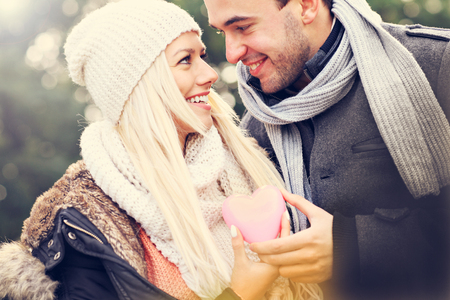 winter woman: A picture of a young happy couple holding heart Stock Photo