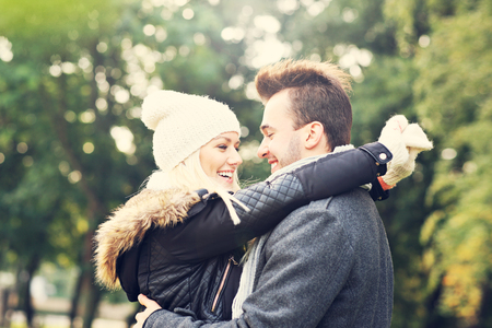 romantic date: A picture of a young romantic couple hugging in the park in autumn