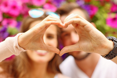 heart hands: A picture of a young romantic couple showing a heart shape