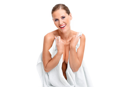female legs: A picture of a sensual woman in a white towel over white background Stock Photo