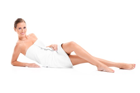 A picture of a sensual woman in a white towel over white background Zdjęcie Seryjne