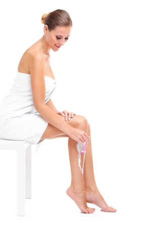 vertical wellness: A picture of a sensual woman shaving legs over white background