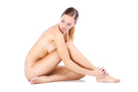nude sexy woman: A portrait of happy naked woman sitting over white background Stock Photo