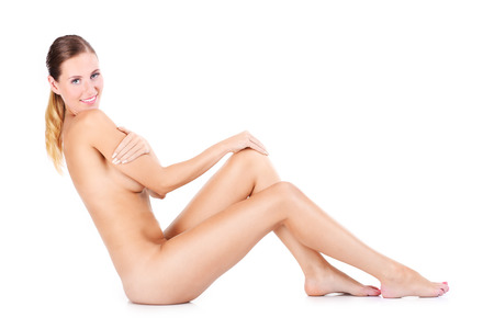 naked woman sitting: A portrait of happy naked woman sitting over white background Stock Photo
