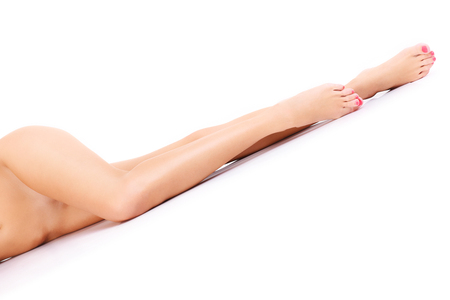 woman naked body: A picture of sensual female legs over white background