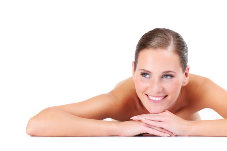 girls naked: Портрет обнаженной женщины, лежащей на синем фоне Фото со стока