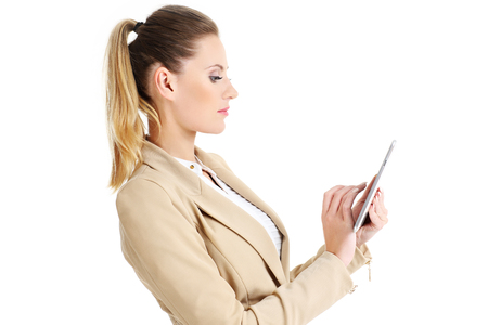 over white: Picture of businesswoman standing with tablet over white background