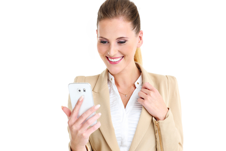 isolated woman: Picture of businesswoman with smartphone over white background Stock Photo