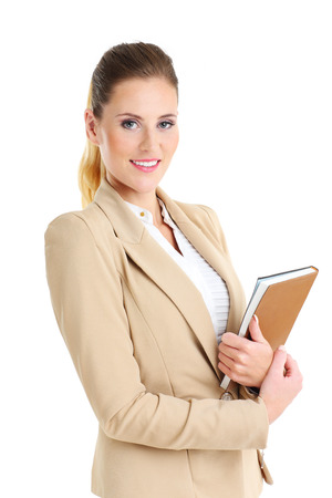 work book: Picture of businesswoman with agenda over white background Stock Photo