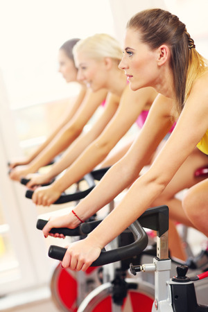 to spin: Picture of sporty women group on spinning class