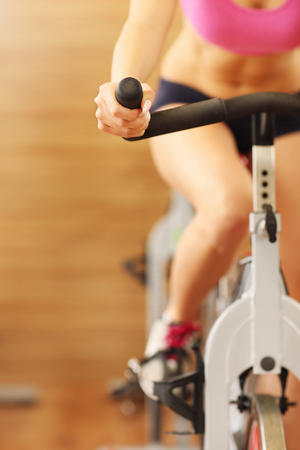 to spin: Midsection of sporty group of women on spinning class Stock Photo