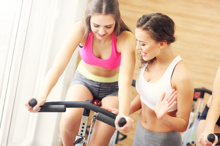 young group: Picture of sporty group of women on spinning class