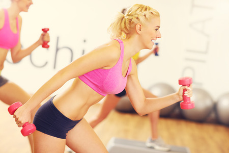 body pump: A picture of group women working out in gym