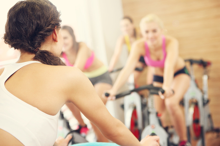 to spin: Picture of sporty group of women on spinning class