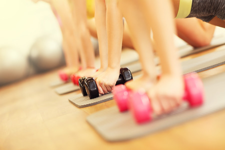 body pump: Picture of women group working out in gym Stock Photo