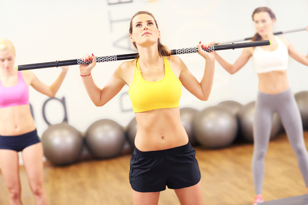 body pump: A picture of female group working out in gym