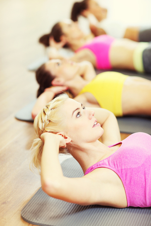 sit ups: Picture of women group working out in gym Stock Photo