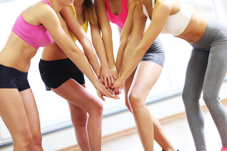 Picture of female group cheering after training Stock Photo