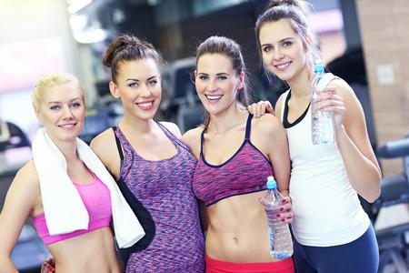 sports club: Picture of friends having break in sports club