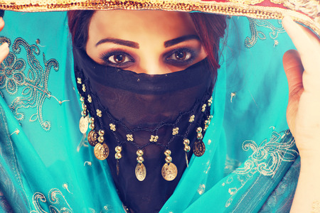 arab glamour: Portrait of beautiful mysterious oriental woman Stock Photo