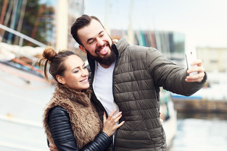 young guy: Picture of young couple taking selfie Stock Photo