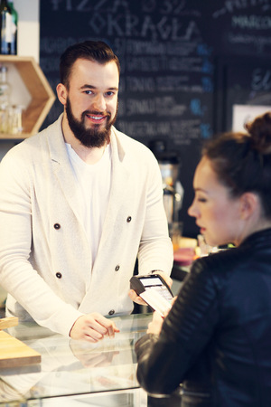 shopping card: Picture of woman paying by credit card in restaurant