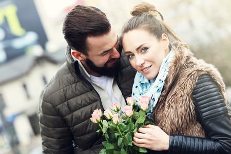 romantic date: Picture of romantic couple on date with flowers Stock Photo