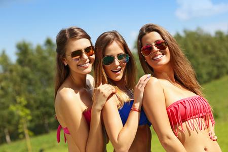 girls in bikini: Picture presenting a group of women in bikin having fun outdoors