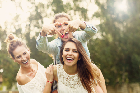 Picture presenting happy group of women having fun outdoors