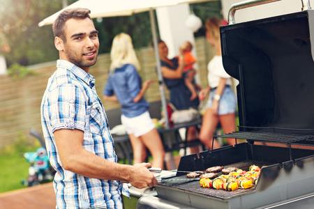 Picture presenting group of friends having barbecue party Stock Photo