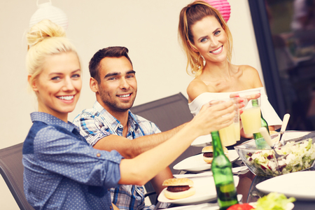 fun in the sun: Picture presenting group of friends having barbecue party Stock Photo