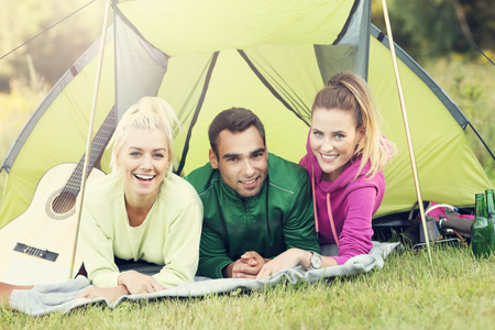 youth group: Picture showing group of friends camping in forest
