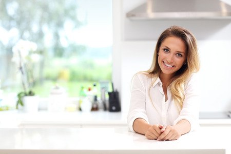 Picture of young woman in the kitchen Stock Photo - 61300084