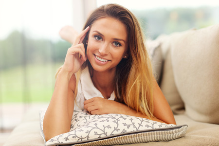 woman on couch: Picture of young woman on couch Stock Photo