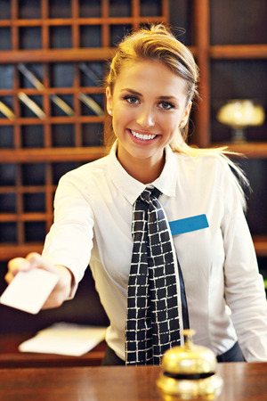 Picture of receptionist giving key card