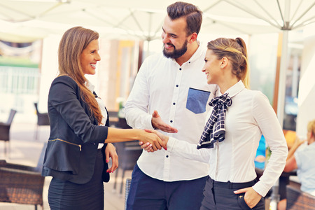 Picture presenting young business people meeting in restaurant Stock Photo