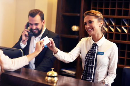front desk: Picture of guests getting key card in hotel Stock Photo