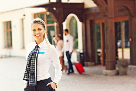 professional woman: Picture showing manager standing in front of hotel Stock Photo