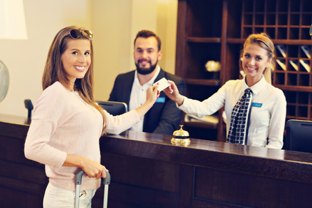 Woman at counter in hotel