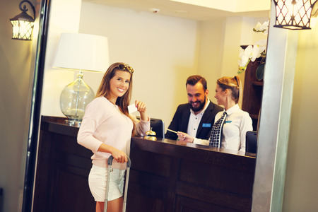 receiving: Woman at counter in hotel