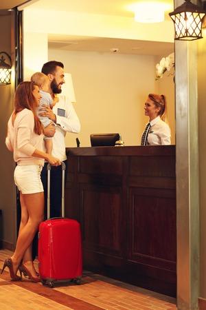 ホテルのチェックインの家族の写真 写真素材