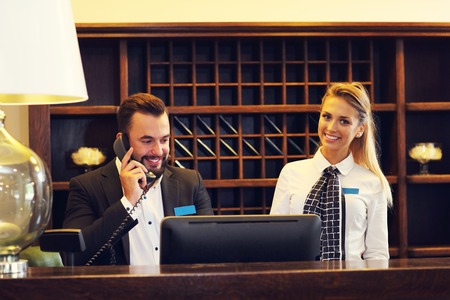 Picture of two receptionists at work Banque d'images
