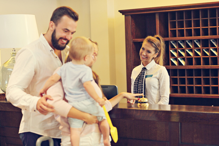 Picture of family checking in hotel