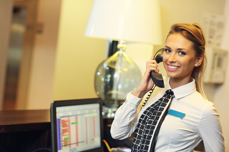 front desk: Picture of pretty receptionist at work