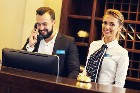 front desk: Picture of two receptionists at work Stock Photo