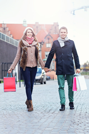 autumn young: Picture showing young couple shopping in the city