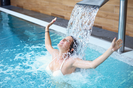 Picture of happy woman relaxing in pool spa Stockfoto