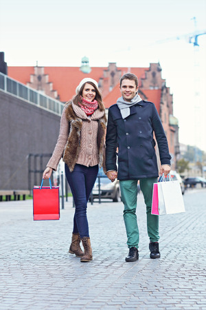 Picture showing young couple shopping in the city